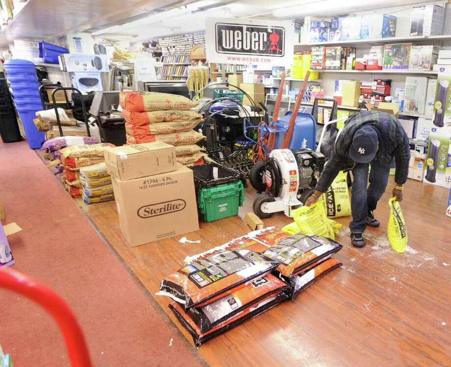A patron of Greenwich Hardware store on Greenwich Avenue buys Ice-A-Way de-icing material, Wednesday afternoon, Feb. 2, 2011. Photo: Bob Luckey / Greenwich Time