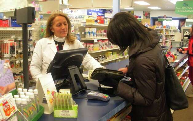 Pharmacy technician Diane Fenwick helps a customer at Candlewood Drugs in New Fairfield. Photo: Contributed Photo/Lidia Ryan, Contributed Photo / The News-Times Contributed