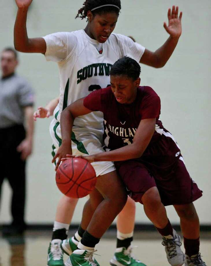 taste - Highlands' #33 Jourdan Doffeny, right, takes on Southwest's #34 Chatavia Boone-Fudge during their game at Southwest High School in San Antonio on Feb. 1, 2011. LISA KRANTZ/lkrantz@express-news.net Photo: LISA KRANTZ, SAN ANTONIO EXPRESS-NEWS / SAN ANTONIO EXPRESS-NEWS