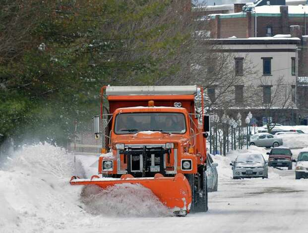 A city truck plows a side street in Saratoga Springs Wednesday afternoon February 2, 2011.   (John Carl D'Annibale / Times Union) Photo: John Carl D'Annibale / 10011954A