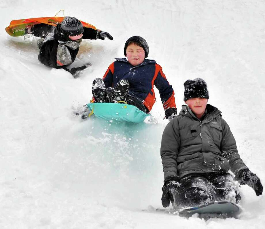 Sledders, from left, Christian Wechgelaer, Eli Fisher and Gray Morrison, all 12 and from Saratoga Springs, enjoy their snow day at High Rock Park in Saratoga Springs Wednesday afternoon February 2, 2011.   (John Carl D'Annibale / Times Union) Photo: John Carl D'Annibale / 10011954A
