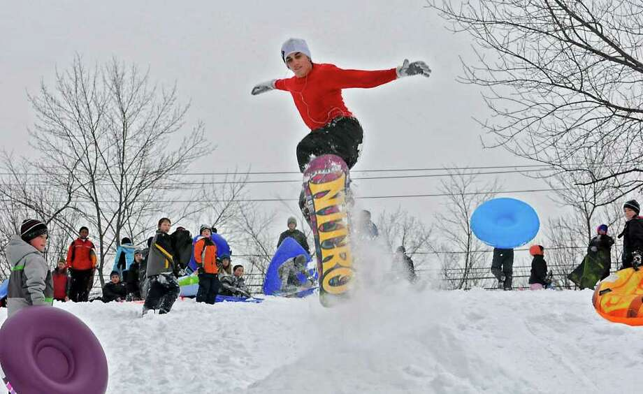 Schenectady County Community College student Paul Beliviau, 20, of Guilderland llstens to music as he catches air on a hill at the Tawasentha Park Winter Recreation Area in Guilderland, NY, on February 2, 2011. (Lori Van Buren / Times Union) Photo: Lori Van Buren
