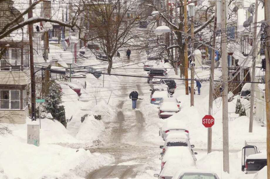 People come out of their homes on Robinson Street in Schenectady, NY, dig out from the second winter storm in two days to hit the Capital Region on Wednesday, Feb. 2, 2011.  (Paul Buckowski / Times Union) Photo: Paul Buckowski / 10011954A
