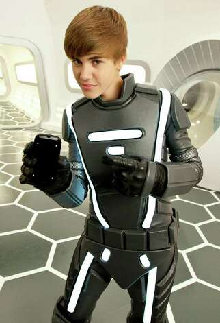 LOS ANGELES, CA - JANUARY 17:  Justin Bieber channels his inner tech-geek on-set for Best Buy's inaugural Big Game commercial on January 17, 2011 in Los Angeles, California.  (Photo by Christopher Polk/Getty Images for Best Buy) Photo: Christopher Polk, Staff / Getty Images North America