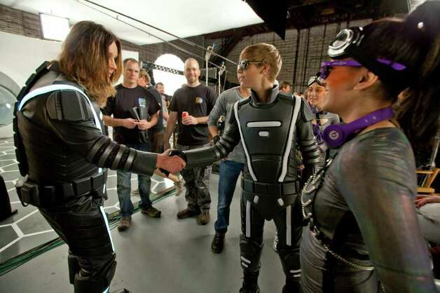 LOS ANGELES, CA - JANUARY 17:  Stars collide as Pop/R&B sensation, Justin Bieber and Rock legend, Ozzy Osbourne meet for the first time on the set of Best Buy's inaugural Big Game commercial, in which they both star on January 17, 2011 in Los Angeles, California. (Photo by Christopher Polk/Getty Images for Best Buy) Photo: Christopher Polk, Staff / Getty Images North America