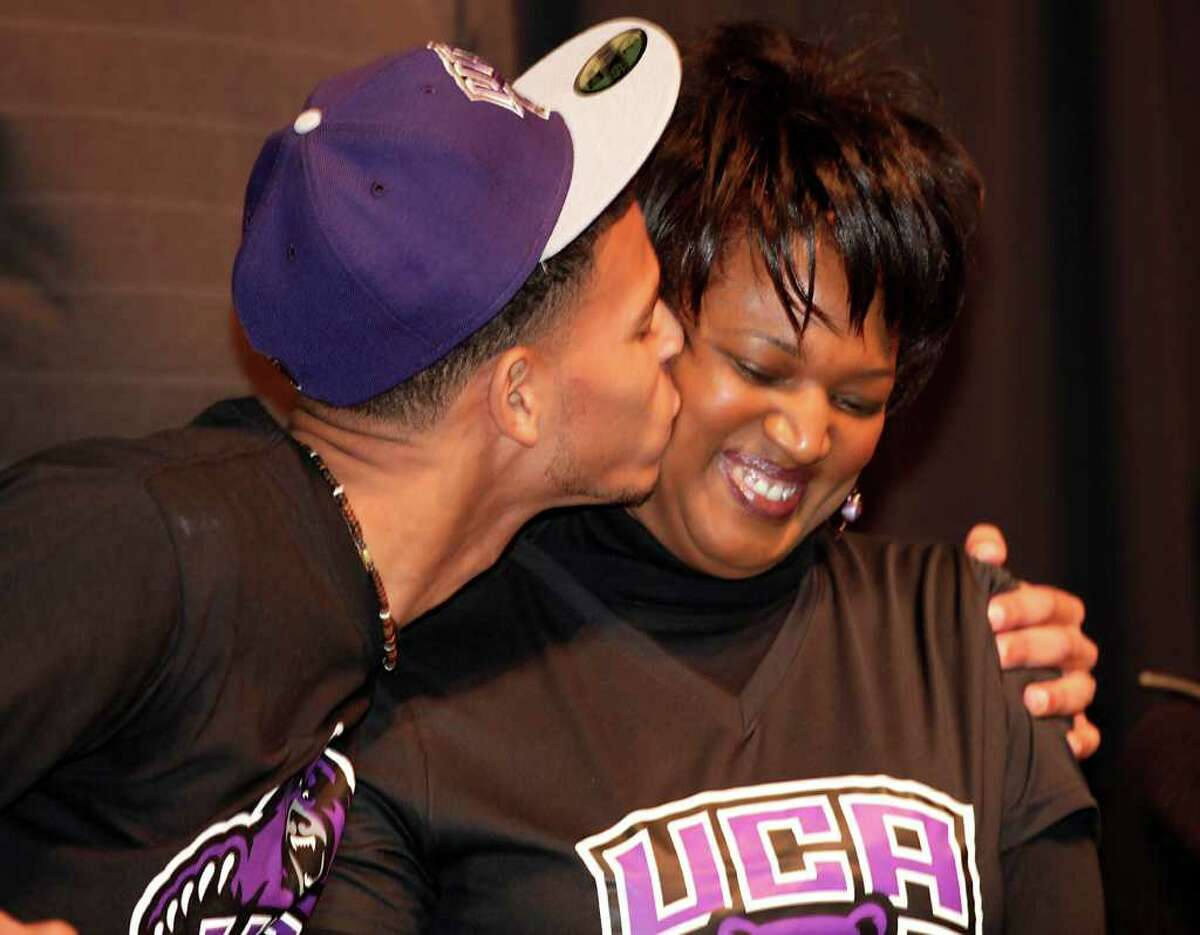 Blake Gardner, left, from Steele High School, kisses his mother Vista Graham after he sign with the University of Central Arkansas to play football, Wednesday, Feb. 2, 2011.