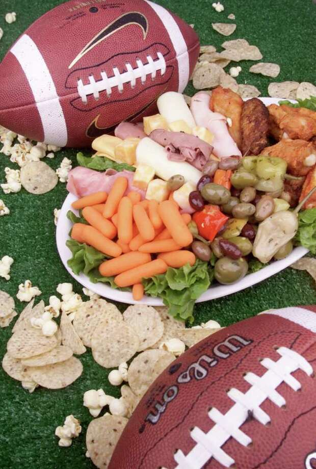 Americans double their consumption of snack foods on Super Bowl Sunday, according to the Snack Food Institute. But vegetables are also on the menu. (Gannett News Service)