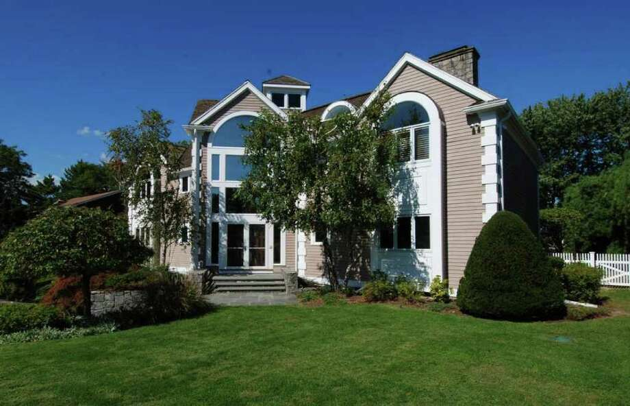 The house at 16 Surf Road in Westport, on the market for $4.15 million, fronts on a lagoon off Long Island Sound and has an indoor pool. Photo: Contributed Photo / Westport News contributed