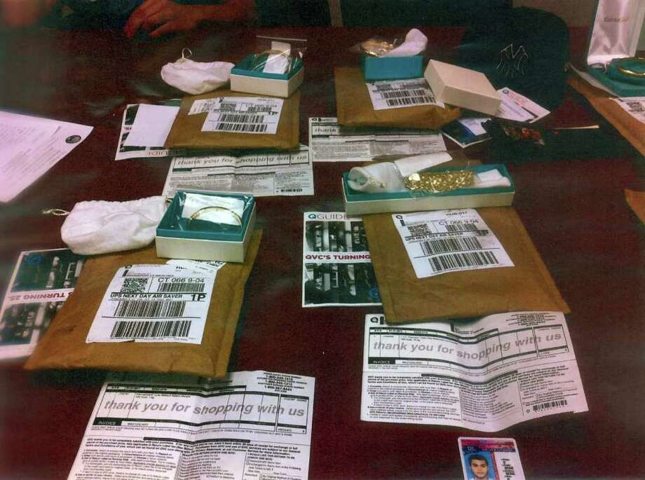 This merchandise shipped by QVC was seized by Bridgeport police. The items were purchased with the use of stolen credit card numbes, police say. Photo: Ned Gerard / Connecticut Post