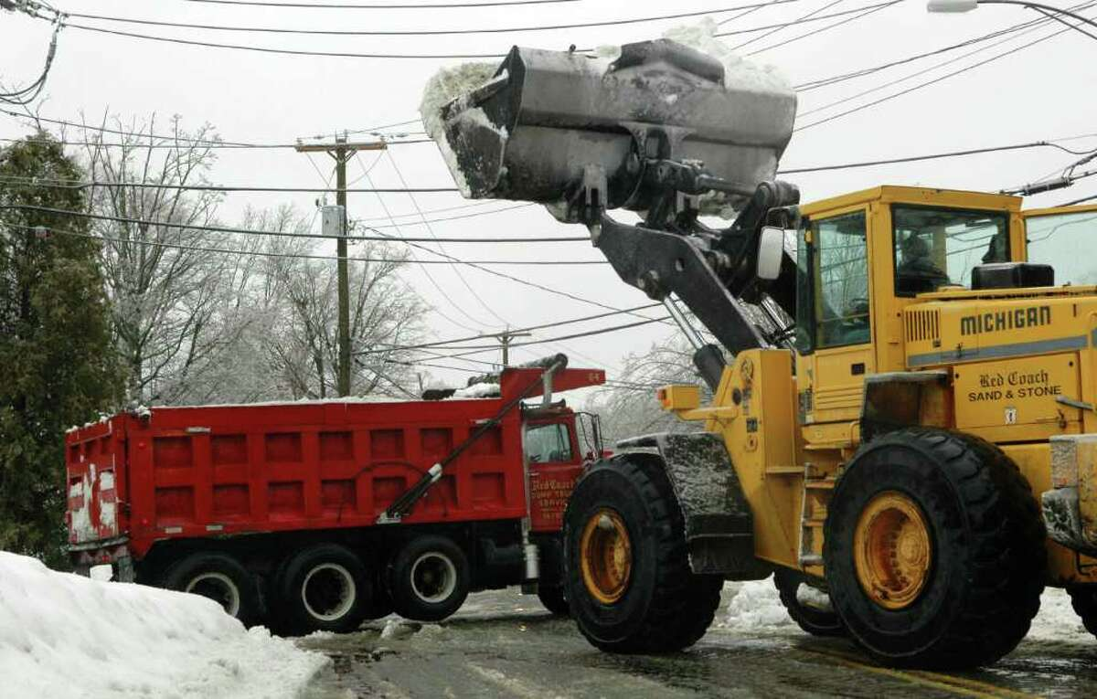 Teams of bucket loaders and dump trucks worked to remove snow and widen streets like Katona Dr. in Fairfield, Conn. on Wednesday, Feb. 2, 2011.