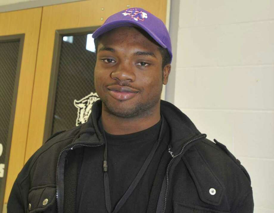 Wearing a SFA hat, Kirbyville running back LeFredrick Ford, is pictured after signing his letter of intent with Stephen F. Austin during signing day at Kirbyville High School gymnasium. The 6-foot-1, 190-pound running back narrowed his list down to Lamar, Stephen F. Austin and Texas A&M before picking the Lumberjacks. He will join former Kirbyville teammate Josh Hughey at SFA. Wednesday, February 2, 2011. Valentino Mauricio/The Enterprise Photo: Valentino Mauricio / Beaumont