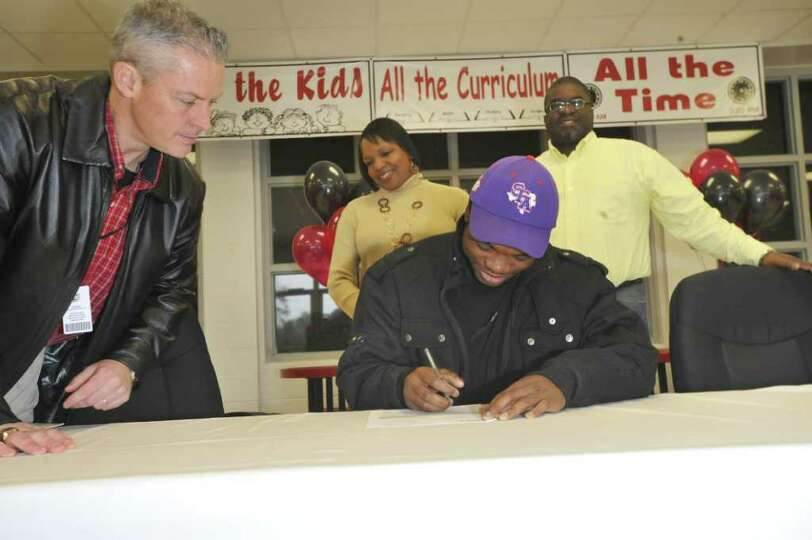 Kirbyville running back LeFredrick Ford, signs his letter of intent with Stephen F. Austin, while Ki