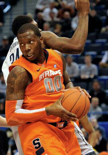 Syracuse's Rick Jackson pulls down a rebound against Connecticut's Alex Oriakhi during the second ha
