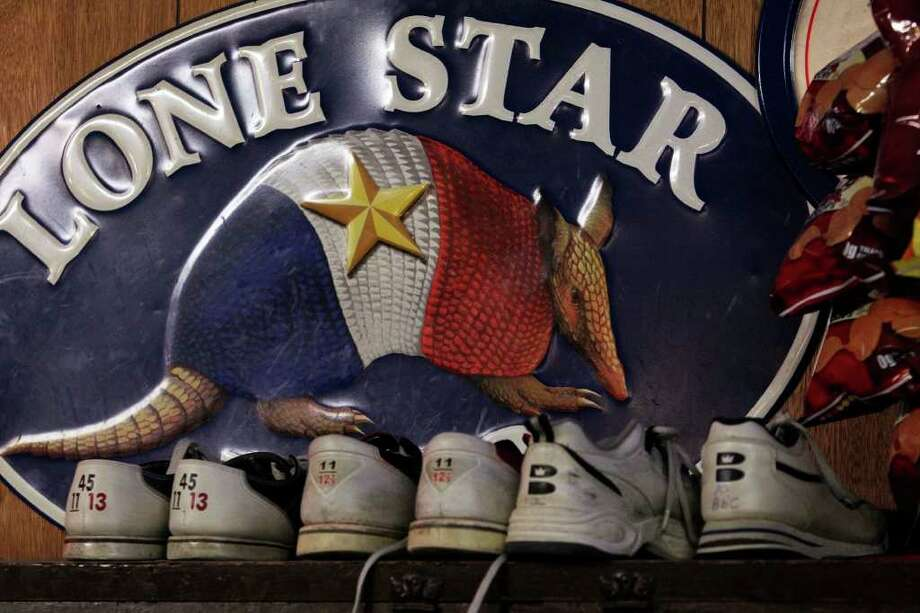 A rack of bowling shoes rests above the bar at the Blanco Bowling Alley Cafe. Photo: TOM REEL / © 2010 San Antonio Express-News
