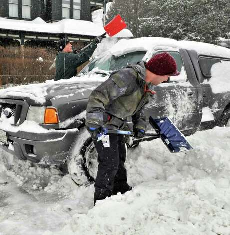 US Navy Petty Officers Mike Cox, left, and Cody Collier dig out their truck plowed in along Union Avenue in Saratoga Springs Wednesday February 2, 2011.   (John Carl D'Annibale / Times Union) Photo: John Carl D'Annibale / 10011954A