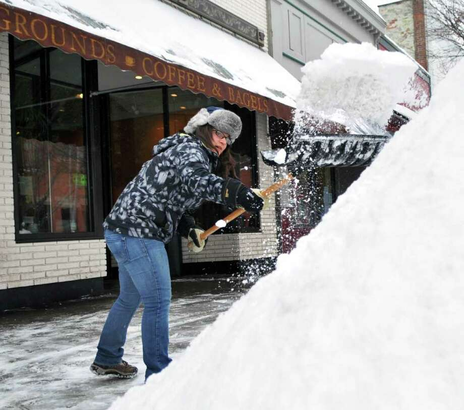 Emelina Spinelli of Saratoga Springs shovels the sidewalk in front of Uncommon Grounds coffee shop on Broadway in Saratoga Springs Wednesday February 2, 2011.   (John Carl D'Annibale / Times Union) Photo: John Carl D'Annibale / 10011954A