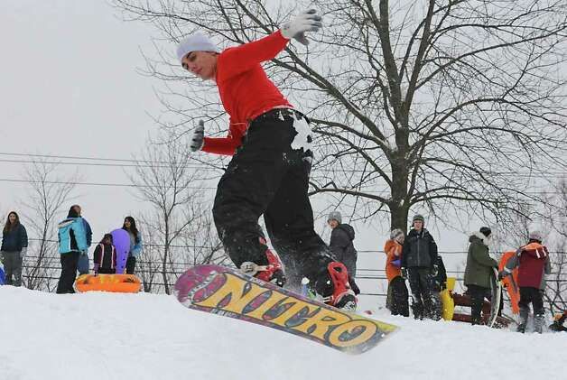 SCCC student Paul Beliviau, age 20, of Guilderland, llstens to music as he gets air on a hill at the Tawasentha Park Winter Recreation Area in Guilderland, NY on February 2, 2011. (Lori Van Buren / Times Union) Photo: Lori Van Buren