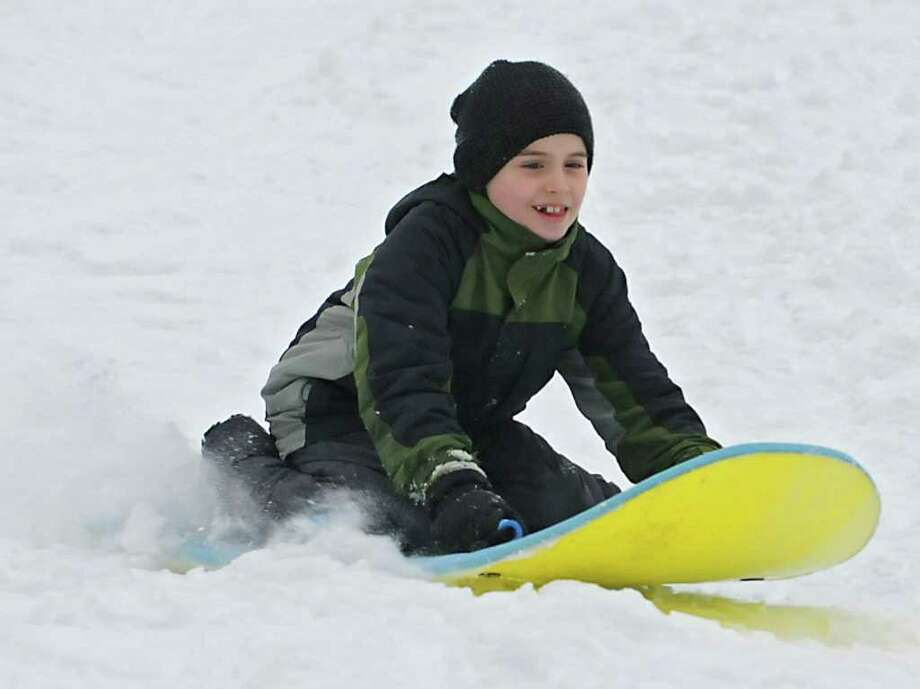 Evan Williams, age 8 of Guilderland, slides down a hill at the Tawasentha Park Winter Recreation Area in Guilderland, NY on February 2, 2011. (Lori Van Buren / Times Union) Photo: Lori Van Buren