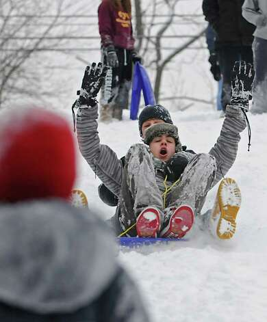 From front, Andrew Pultz, 14 of Menands, and Rico Battibulli, 14 of Colonie, enjoy a snow day from school as they ride down a hill at the Tawasentha Park Winter Recreation Area in Guilderland, NY on February 2, 2011. (Lori Van Buren / Times Union) Photo: Lori Van Buren