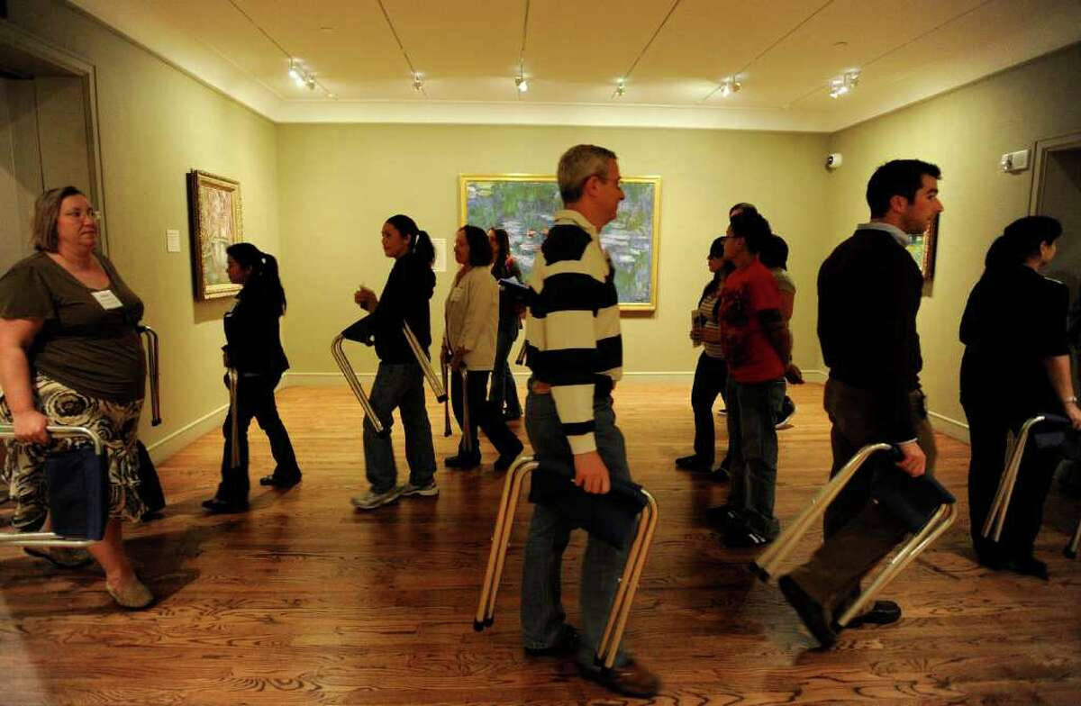 Medical and nursing students in the UT Health Science Center's Art Rounds program of the Center for Medical Humanities & Ethics walk through the McNay to observe works of art.