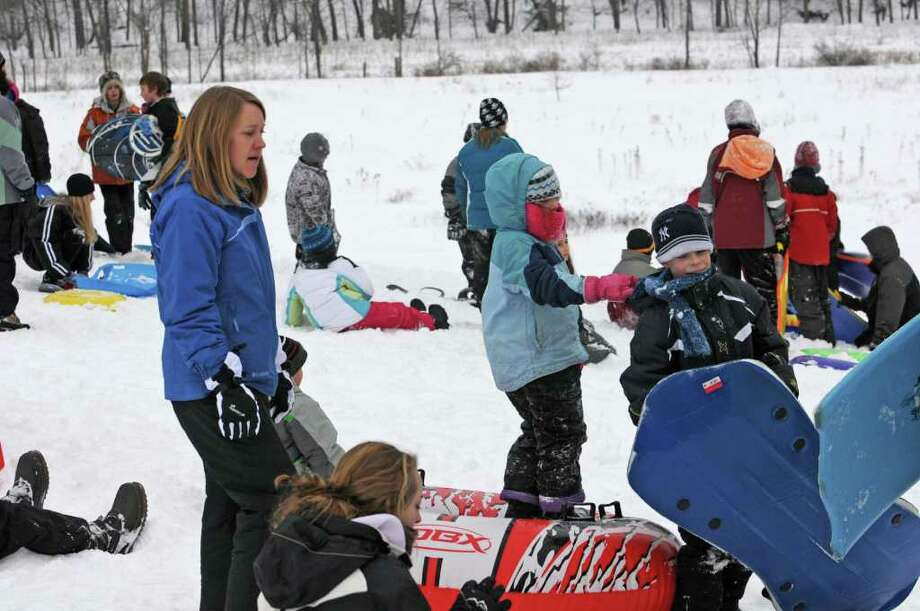 Parents take their kids to ride their sleds down a hill at the Tawasentha Park Winter Recreation Area in Guilderland, NY, on February 2, 2011. A snowstorm caused all the schools to have a snow day. (Lori Van Buren / Times Union) Photo: Lori Van Buren