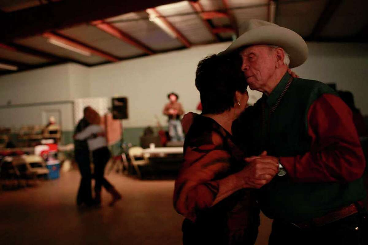 METRO - David and Joann Vanloh, of Stockdale, move to the music of the Jeff Thompson Band, during the dance with the South Texas Trail Riders, Inc. 52nd annual Trail Ride to the San Antonio Stock Show and Rodeo at the Wilson County Show Barn in Floresville on Wednesday, Feb. 2, 2011. LISA KRANTZ/lkrantz@express-news.net