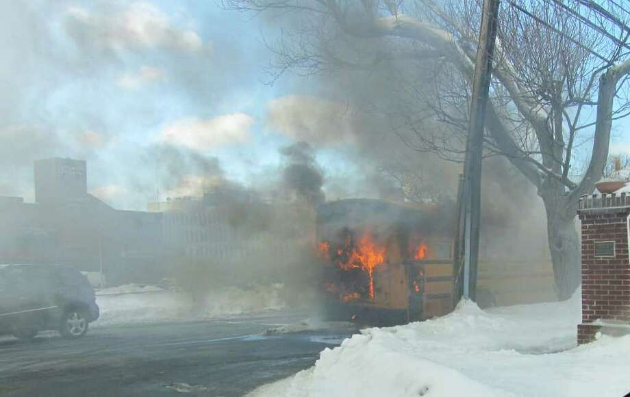 A school bus erupted into flames after dropping students off at Toquam Magnet Elementary School Thursday morning. Photo: Contributed Photo / Stamford Advocate Contributed
