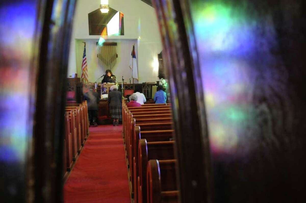 Parishioners kneel at the altar during a service at Little Bethel African Methodist Episcopal Church on Sunday, Jan. 30, 2011.