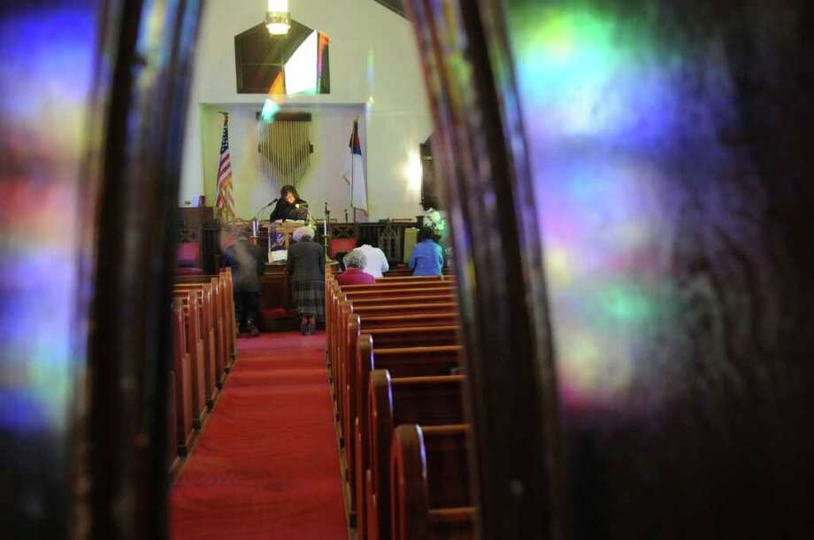 Parishioners kneel at the altar during a service at Little Bethel African Methodist Episcopal Church on Sunday, Jan. 30, 2011. Photo: Helen Neafsey / Greenwich Time