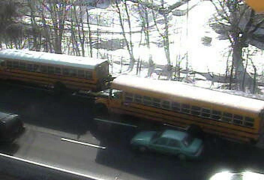 A school bus on Interstate 95 Northbound on the Moses Wheeler Bridge was struck by flying ice off of the top of a tractor-trailer on Thursday, Feb. 3, 2011. There were minor injuries. Photo from the DOT traffic camera. Photo: Contributed Photo