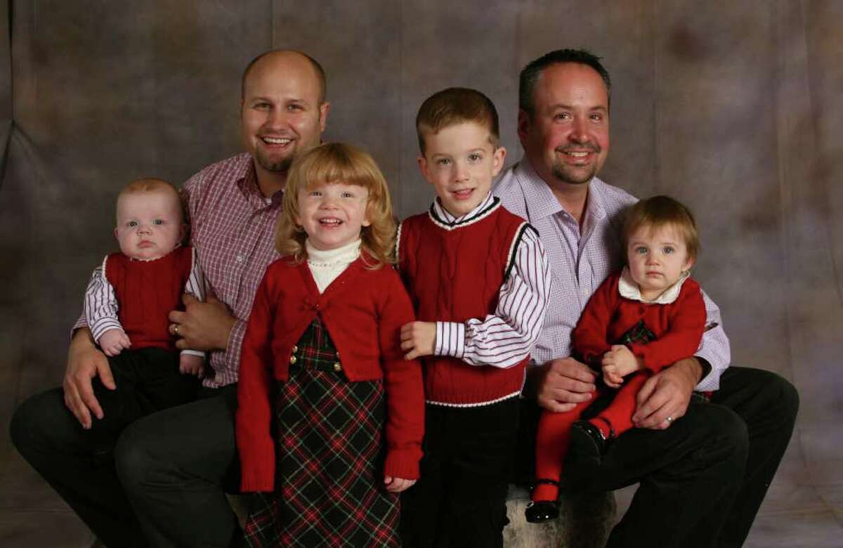 Brian, left, holds Jace in this Lindwall-Thomas family photo from Christmas of 2008. Amber and Dylan are standing. Erik is on the right, holding Natalie.