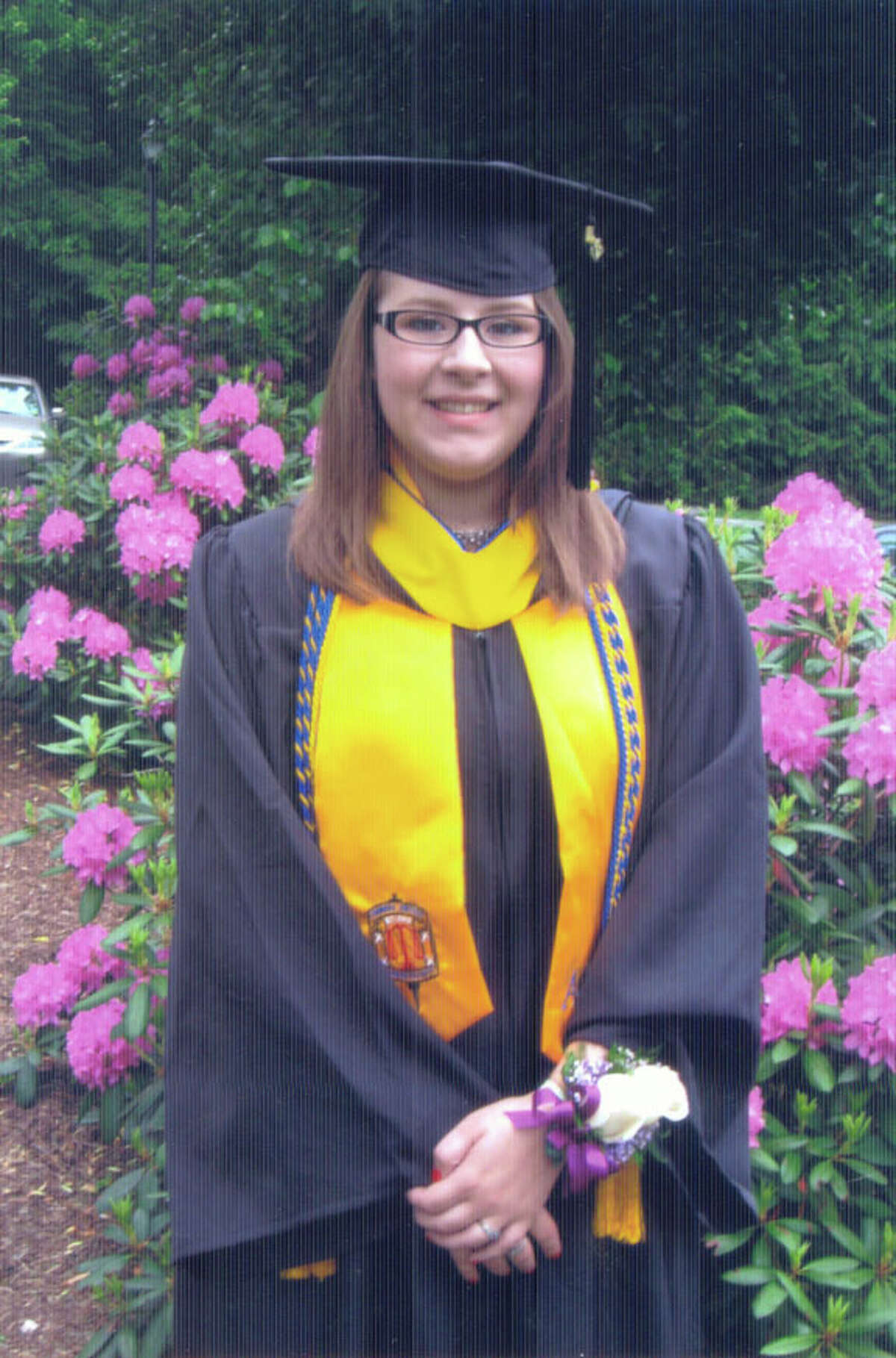 """Rachael Levine, 22, of Danbury, was adopted when she was 17. """"I never felt as loved, cared about, or provided for like I felt once I met my adopted family,"""" she said. Levine graduated magna cum laude with a degree in justice and law administration from Western Connecticut State University in 2010. She said positive experiences with the foster care system inspired her to pursue a career as an attorney for child protective services."""