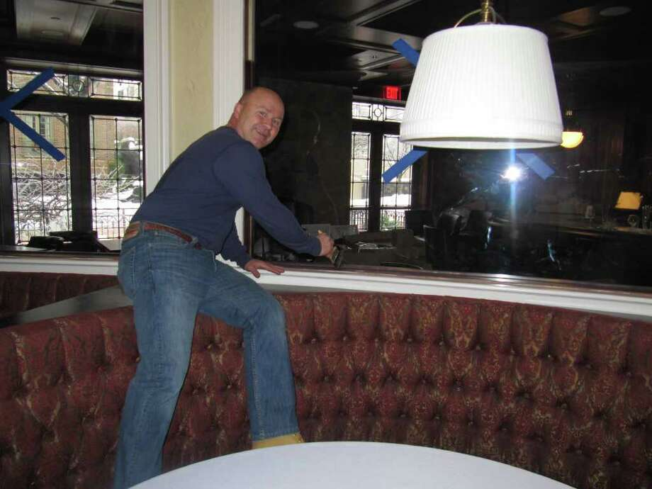 Tony Capasso, general manager of Gabriele's on Church Street in Greenwich, applies some finishing touches in preparation for the Feb. 10 opening. Photo: Contributed Photo / Stamford Advocate Contributed