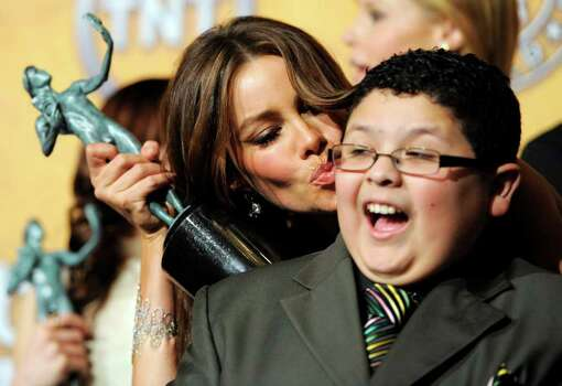 "Sofia Vergara and Rico Rodriguez pose together with their best comedy series trophies for ""Modern Family"" at the 17th Annual Screen Actors Guild Awards on Sunday, Jan. 30, 2011 in Los Angeles. Photo: AP"