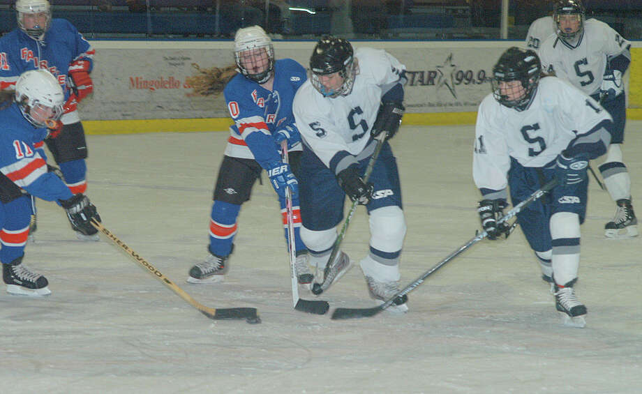 Fairfield's girls hockey team squared off against Staples on Saturday afternoon at Rinks at Shelton. Photo: Andy Hutchison, Contributed Photo / Fairfield Citizen contributed