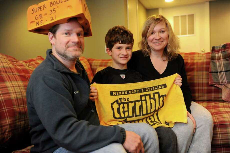 The Wincentsen family poses for a photo in their Fairfield home on Wednesday, February 2, 2011. From left are Packers fan Craig and his Steelers fan son and wife, Jordan, 12, and Patty, right. Photo: Lindsay Niegelberg / Connecticut Post