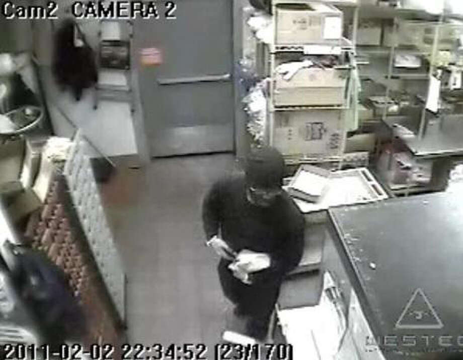 A man wearing black, military-style camouflage paint on his face, shown here in a surveillance photo provided by Greenwich police, robbed Wendy's restaurant on West Putnam Avenue on Wednesday night using a gun to demand cash and then fled the scene, policesaid. The robbery occurred at around 10:30 p.m. Wednesday just as the restaurant's dining room wasclosing. Photo: Contributed Photo / Greenwich Time Contributed