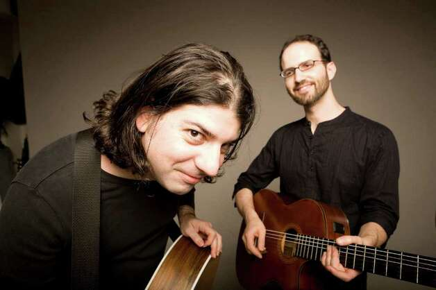 The Isra-Alien guitar duo, (Gilad Ben-Zvi, left, on steel strings, and Oren Neiman on nylon strings) performing world music with a Mediterranean-Gypsy-Jewish-Klezmer flair, visits the Wien Experimental Theatre at Fairfield University's Quick Center for the Arts on Feb. 13 at 2 p.m. Photo: Contributed Photo / Connecticut Post Contributed