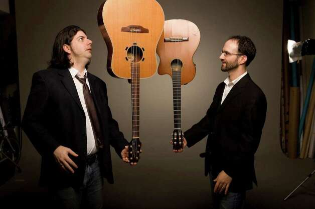 The Isra-Alien acoustic guitar duo (Gilad Ben-Zvi, left, on steel strings, and Oren Neiman on nylon strings) performs world music Feb. 13 at 2 p.m. at Fairfield University's Regina A. Quick Center for the Arts. Photo: Contributed Photo / Connecticut Post Contributed