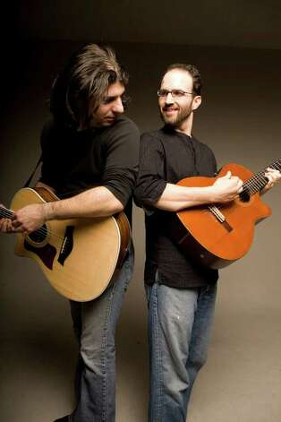 The Isra-Alien acoustic guitar duo (Gilad Ben-Zvi on steel strings, left, and Oren Neiman on nylon strings) performs world music Feb. 13 at 2 p.m. at the Wien Experimental Theatre at Fairfield University's Quick Center for the Arts. Photo: Contributed Photo / Connecticut Post Contributed