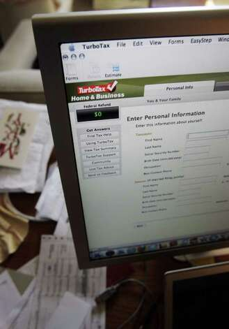A good activity for a snow day is to get a jump start on your taxes. (AP Photo/Paul Sakuma, FILE)
