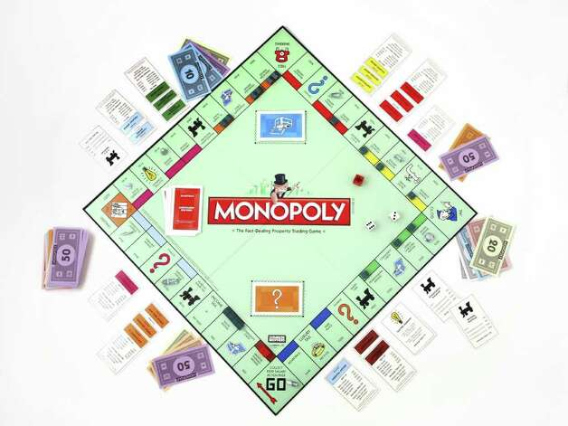 This file product image provided by Hasbro, shows the board game Monopoly. Board games like Monopoly are great for snow days. (AP Photo/Hasbro, FILE)
