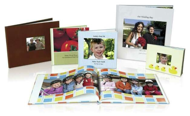 This file product image courtesy of Shutterfly shows an assortment of photo books available through Shutterfly. A good activity for a snow day is to make a photo book with old scanned photographs. (AP Photo/Shutterfly, FILE)