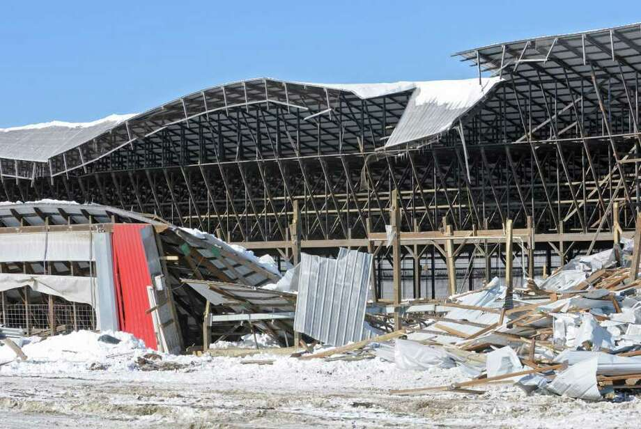 Heavy snow collapsed a cow barn at the King's Ransom Farm in Northumberland, killing or injuring more than 70 cows. (Lori Van Buren / Times Union) Photo: Lori Van Buren