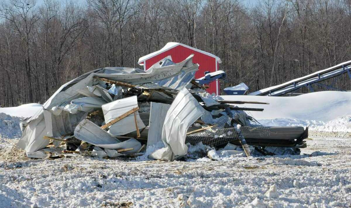Heavy snow collapsed a cow barn at the King's Ransom Farm in Northumberland, killing or injuring more than 70 cows. (Lori Van Buren / Times Union)