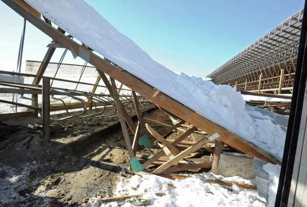 Heavy snow collapsed the roof of a barn at the King's Ransom Farm in Northumberland. More than 70 cows were killed and injured in the collapse.  (Lori Van Buren / Times Union) Photo: Lori Van Buren