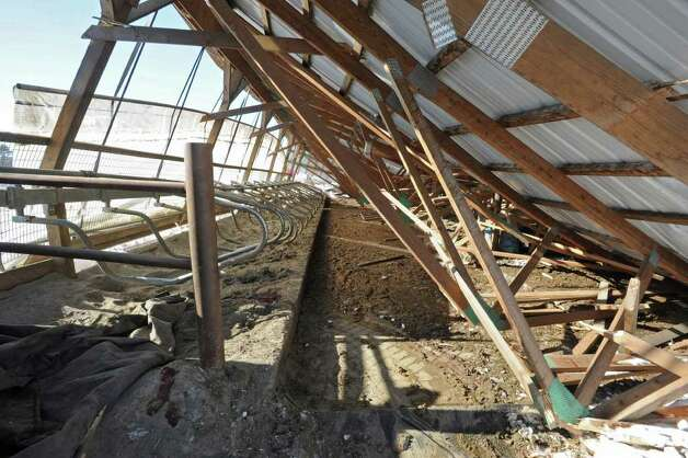 The roof of a cow barn at the King's Ransom Farm in Northumberland was collapsed by heavy snow, killing dozens of cows.  (Lori Van Buren / Times Union) Photo: Lori Van Buren
