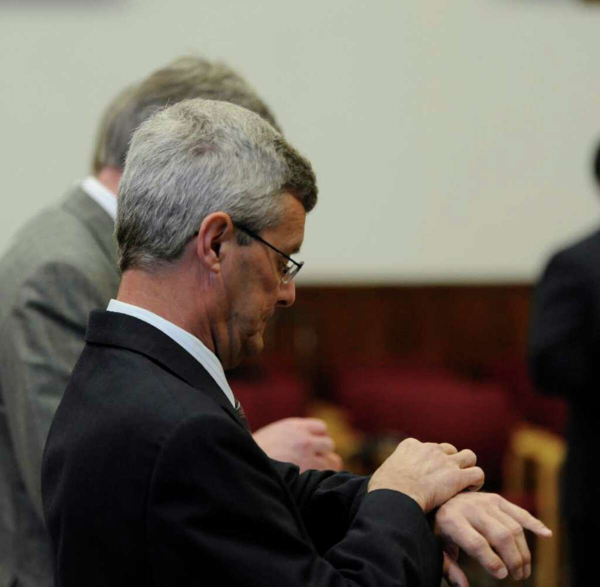 Ex-priest Gary Mercure checks his watch during a break in his trial. He was convicted of sexual abusing two boys in the 1980s. (Skip Dickstein / Times Union)