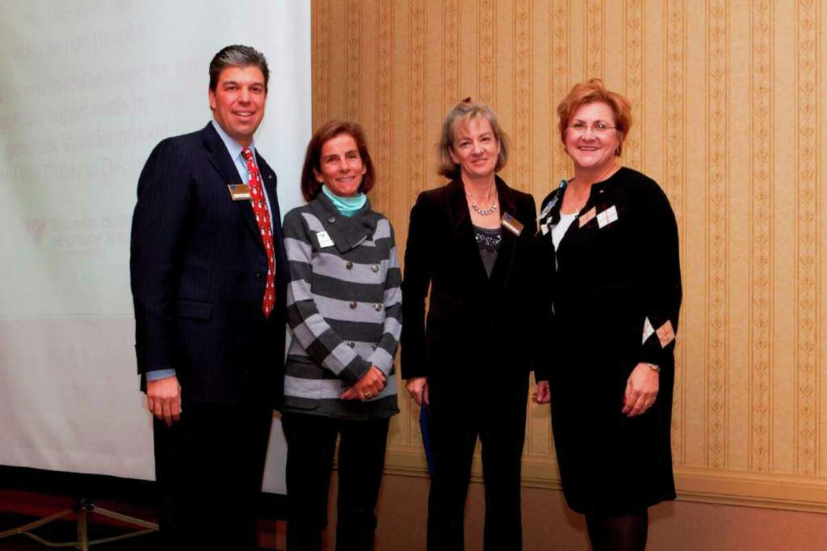 From left: Bridgeport Hospital Foundation President Steve Jakab, former Bridgeport Hospital Woman's Staff President Sally Cummings of Fairfield, current Woman's Staff President Marjorie D'Elia of Black Rock and hospital Director of Development Susan Chudwick, attend the awards. The Woman's Staff received a Partners in Philanthropy award for its grant to the hospital Newborn ICU to purchase a special incubator.
