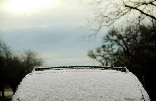 A vehicle traveling along Highway 46 in Boerne sports a fine covering of snow on Wednesday morning, Dec. 10, 2008. A cold front passed through the area, sprinkling snow north of San Antonio and causing temperatures to dip into the low to mid '30s.  BILLY CALZADA / gcalzada@express-news.net Photo: BILLY CALZADA, SAN ANTONIO EXPRESS-NEWS / gcalzada@express-news.net